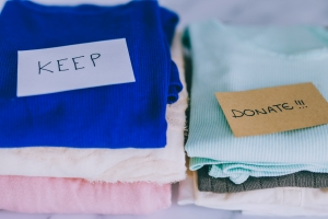 Graphic for donating clothes with keep and donate piles