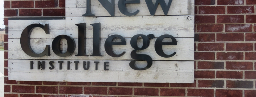 Wooden and metal sign that says New College Institute