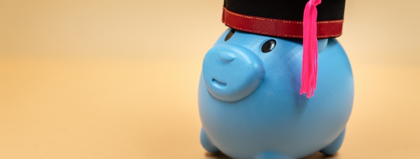 Image of piggy bank with graduation cap