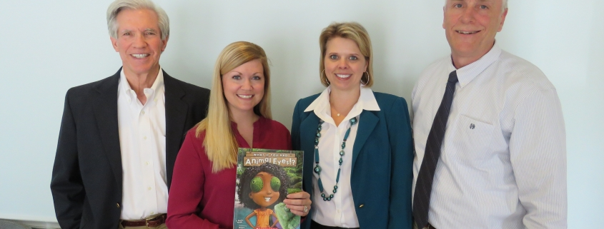 Employees at Jones Deshon Orthodontics and NCI pose for Reading for Life Program