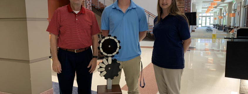 STAGS Robotics Team members poses beside Challenge Cup trophy
