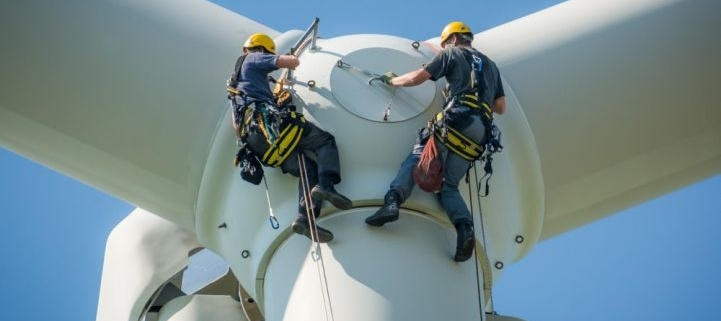 Workers fixing a wind turbine