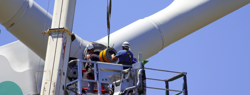 Worker fixing an offshore wind turbine